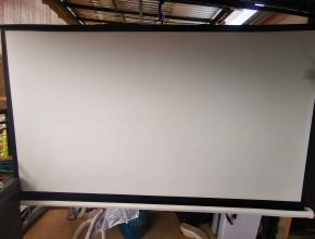 Is a black or white projector screen better?